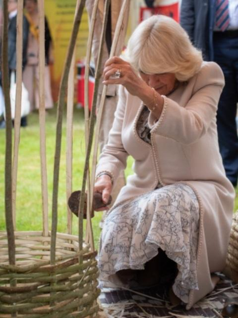 Her Royal Highness the Duchess of Cornwall weaving a hive