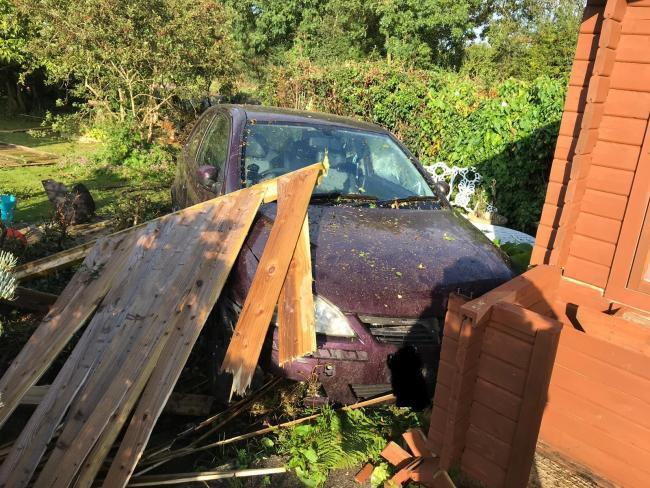 Cars keep swerving off the sharp bend and crashing into Tim Handy's front garden