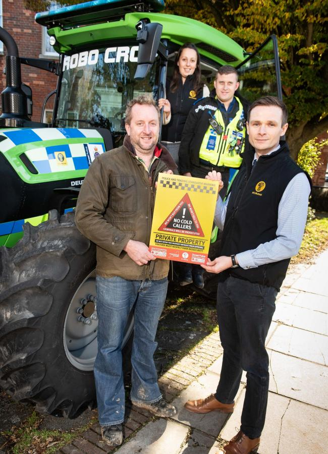 Joe Foot, Dorchester NFU Branch Chairman & Matt Uren Dorchester NFU Mutual holding the warning sign and Rural Crime Officer PC Tom Balchin & Lucy Ngapo, NFU Mutual.