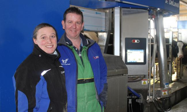 Sarah Haworth and David Luxton with the robotic milking system