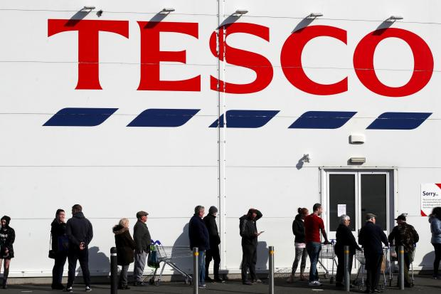 South West Farmer: People queue outside a Tesco Extra store in Madeley, Shropshire