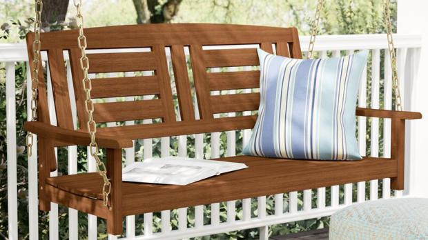 South West Farmer: How quaint is this wooden porch swing? Credit: Wayfair