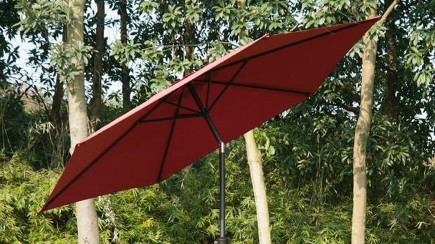 South West Farmer: This umbrella tilts to better block the sun. Credit: Wayfair