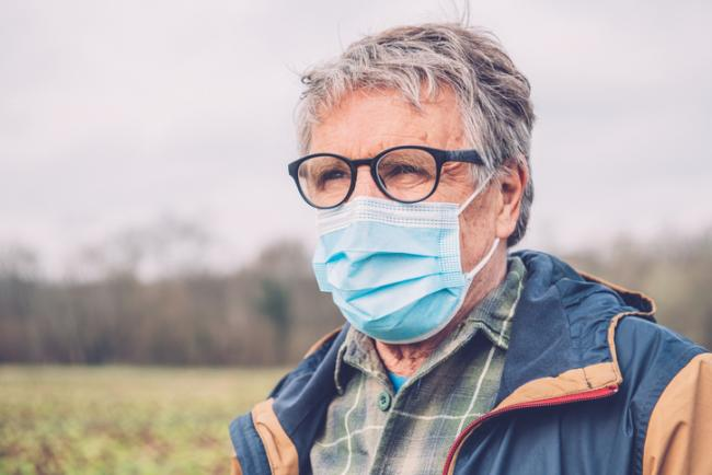 Man wearing mask in field