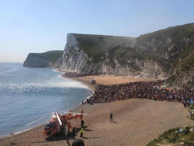 Helicopters land on the beach after two were injured jumping from Durdle Door Picture: Purbeck Police