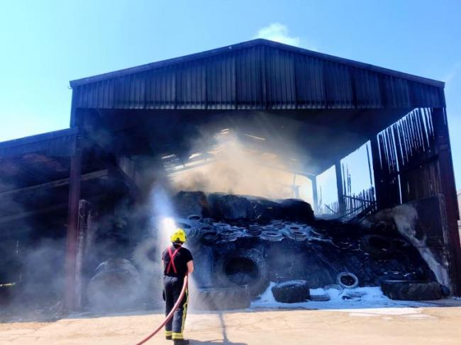 Aftermath of barn blaze tackled by dozens of firefighters