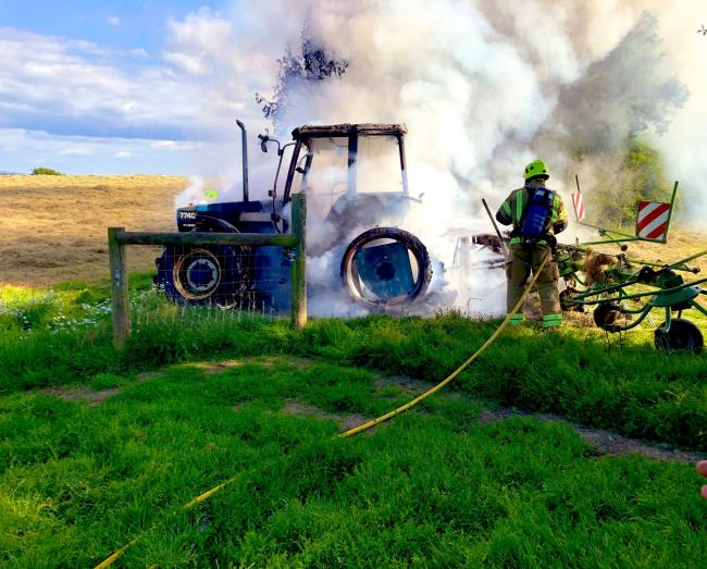 The tractor on fire. Picture: Launceston Community Fire Station