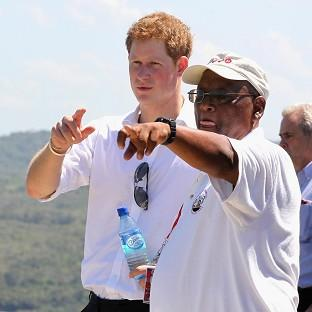 Prince Harry talks to a local guide during a visit to a national monument in Belize