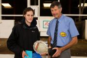 Hilary Bond (left) receives her trophy from Golden Shears president Philip Morrison