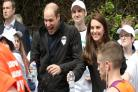 William, Kate and Harry make a splash as they cheer on marathon runners
