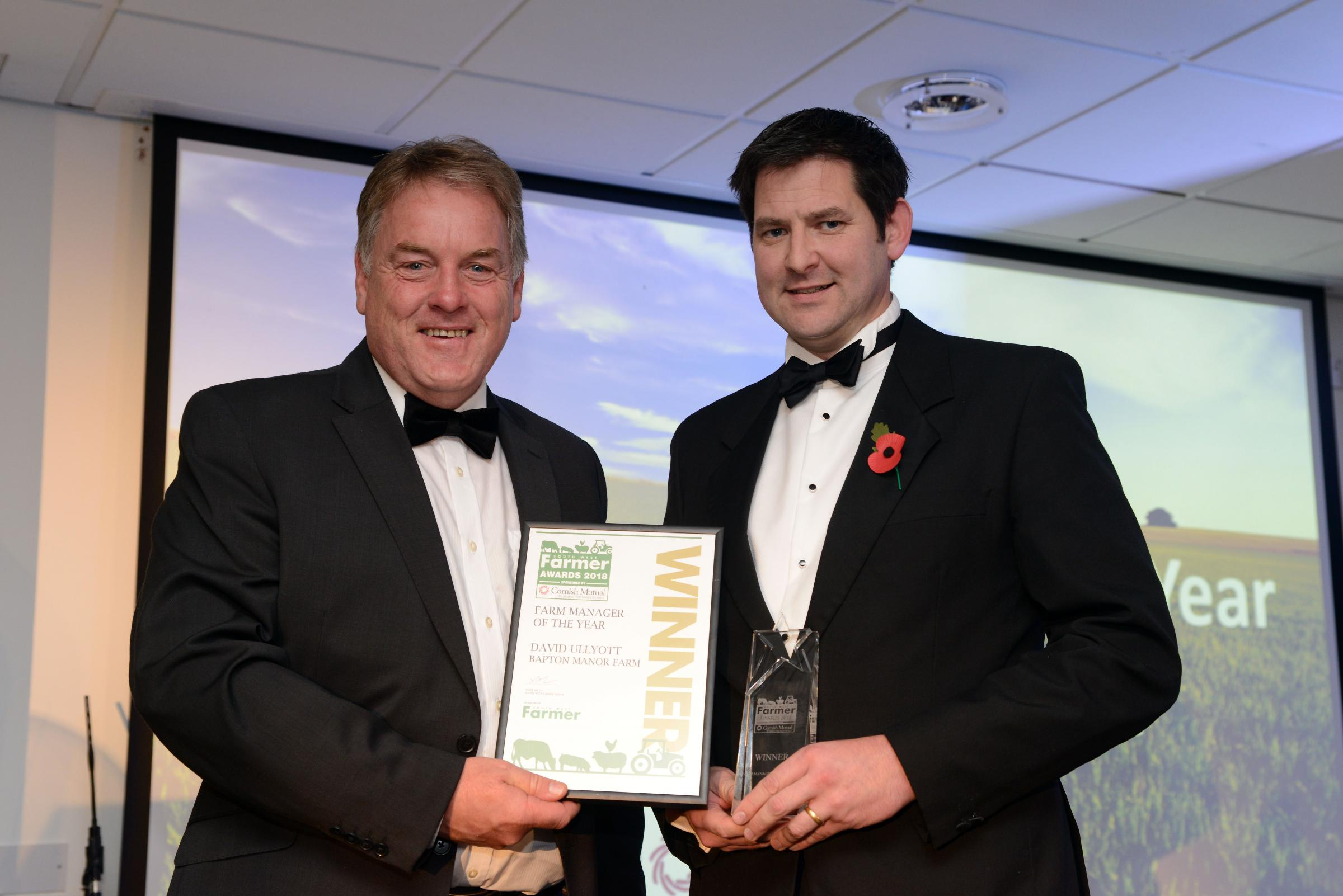 The South West Farmer Awards 2018. Pictured Stephen Dennis of the Farming Community Network with winner of the Farm Manager award David Ullyott from Bapton Manor Farm.