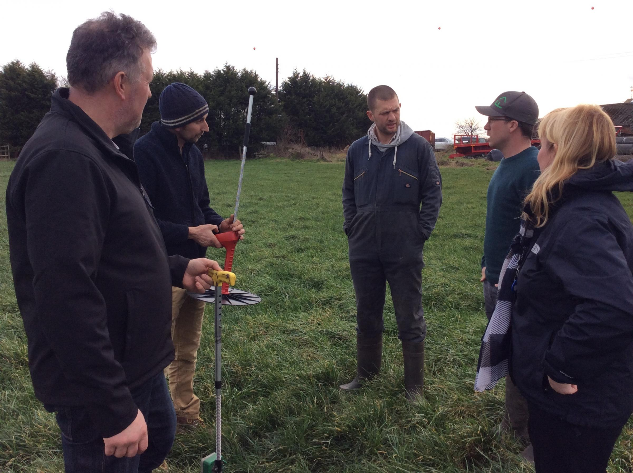 GrassCheckGB pilot farmers test out Plate Meters at Fourth Milestone Farm near York during a Farmer set-up meeting for the new grassland improvement initiative