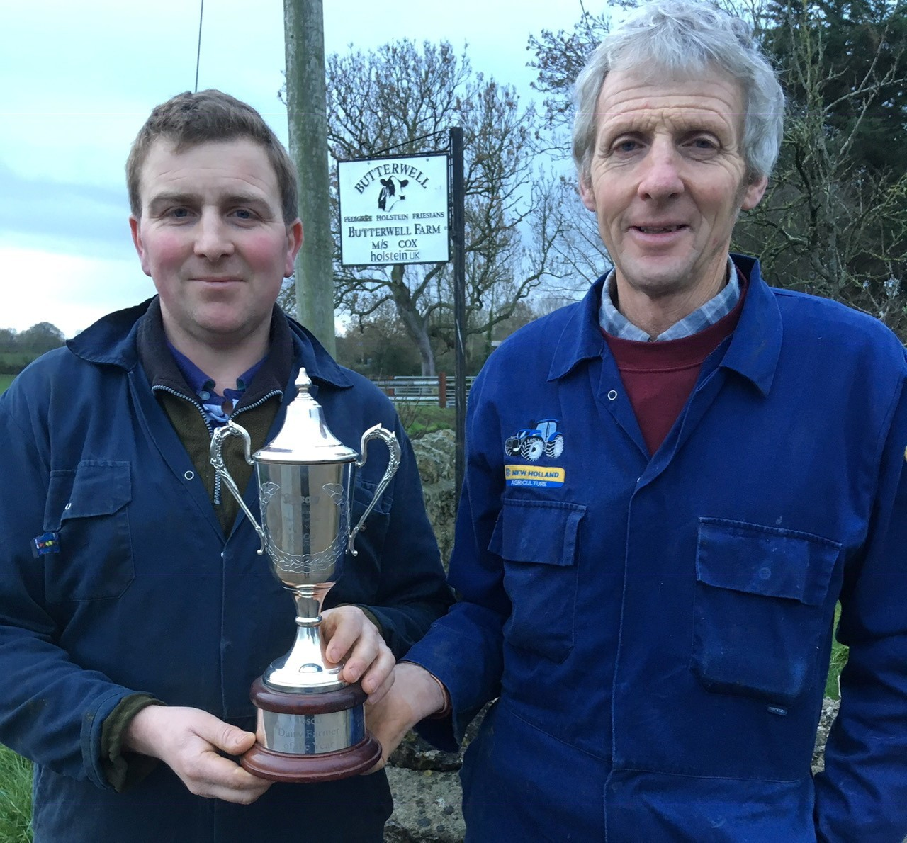 Adrian and his dad Stephen with the TSDG farmer of the year cup